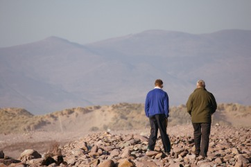 Men walking on the irish Westcoast.