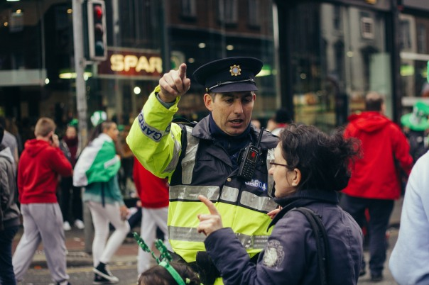 A police officer helps out.