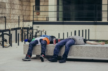 Exhausted men during St. Patrick's day.