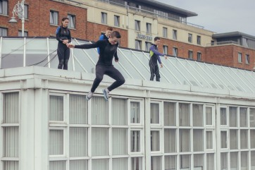 A young man jumps down a building into the Liffey.