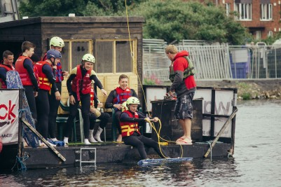 Some people practicing water sports in the Docklands.