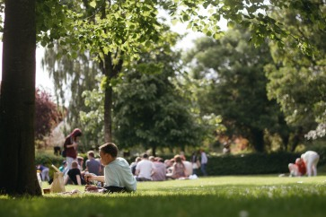 People lying on the gras in St. Stephen's Green Park.