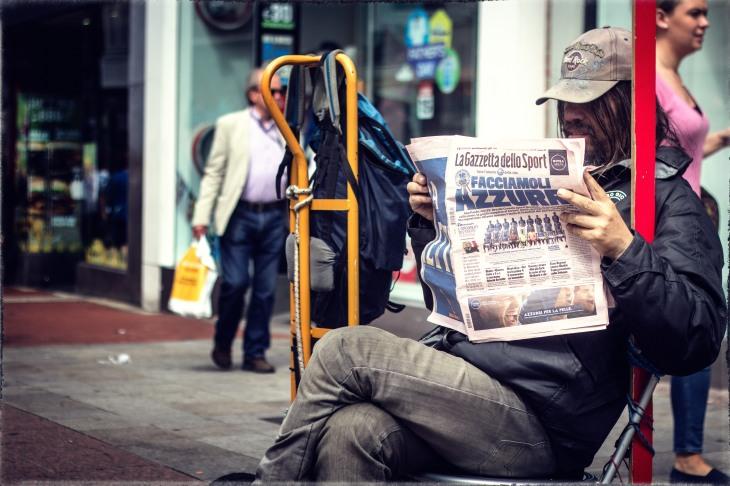 A street musician enjoying his break.