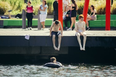 People bathing in the Docklands of Dublin.
