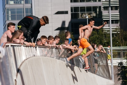 Young People jumping into the Water in Dublin.